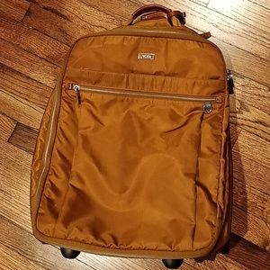 Gently used Tumi carry-on suitcase roller bag